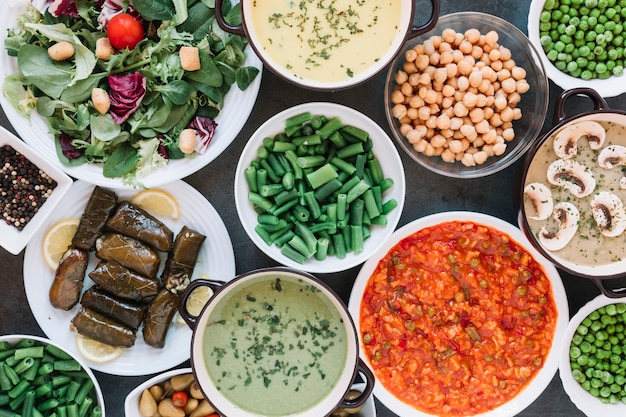 Flat lay of dishes with green beans and chickpeas