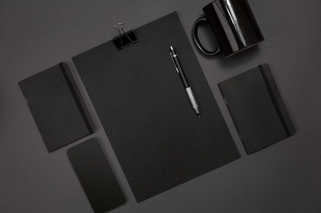 Flat lay display of business office gadgets with notepad, cup, pen, develop, glasses and etc. top