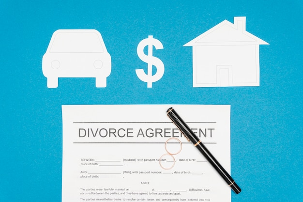 Flat lay divorce agreement with pen