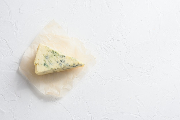 Flat lay of dor blue cheese on stone surface