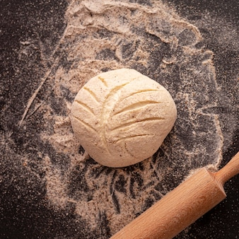 Flat lay dough with rolling pin