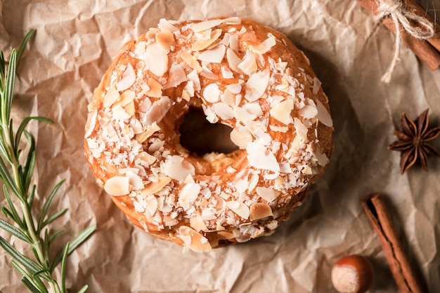 Flat lay of doughnut with rosemary and cinnamon