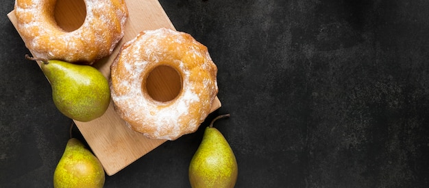 Flat lay of doughnuts with pears and copy space