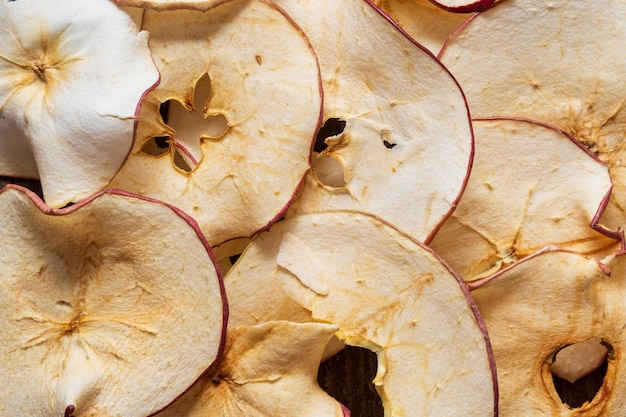 Flat lay of dried apples chips background.