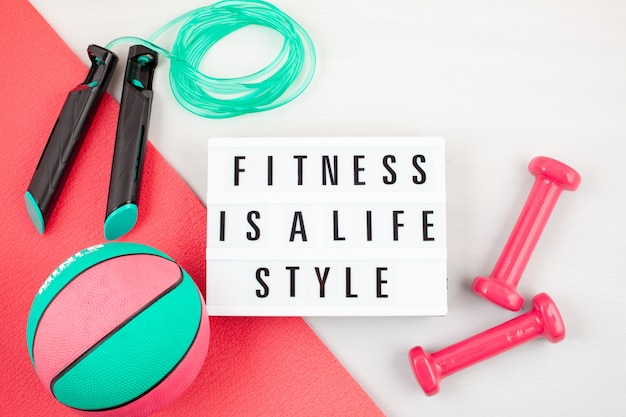 Flat lay of dumbbell, sport and fitness equipments