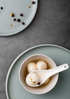 Flat lay of dumplings and spoon