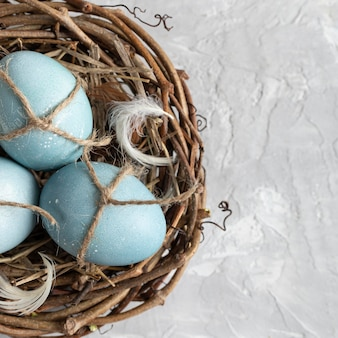Flat lay of easter eggs in bird nest