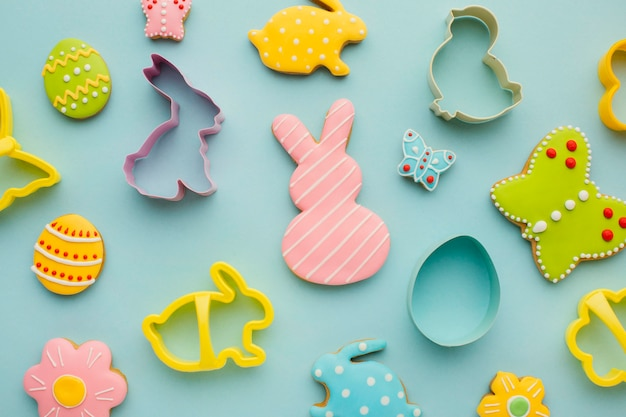 Flat lay of easter eggs with bunny and butterfly shapes