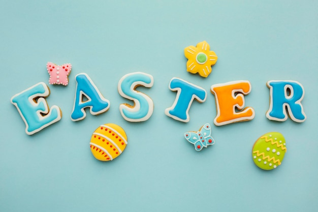 Flat lay of easter eggs with flower and butterfly shapes