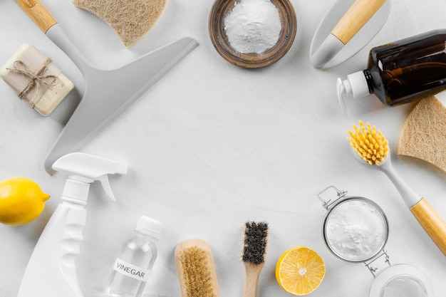 Flat lay of eco cleaning products with lemon and baking soda
