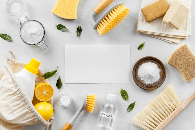 Flat lay of eco-friendly cleaning products collection with brushes and baking soda