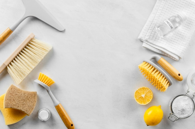 Flat lay of eco-friendly cleaning products collection with brushes