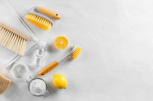 Flat lay of eco-friendly cleaning products collection with copy space