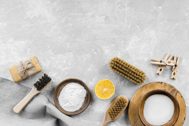 Flat lay of eco-friendly cleaning products with baking soda and copy space