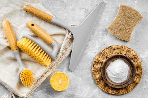 Flat lay of eco-friendly cleaning products with brushes and baking soda