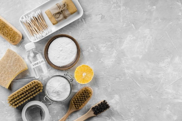Flat lay of eco-friendly cleaning products with copy space and baking soda