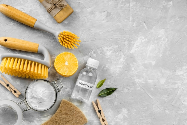 Flat lay of eco-friendly cleaning products with copy space