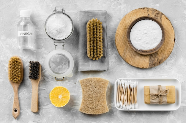 Flat lay of eco-friendly cleaning products with lemon and baking soda