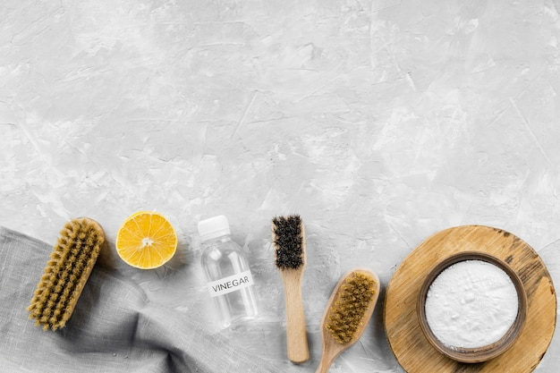 Flat lay of eco-friendly cleaning products with lemon and copy space