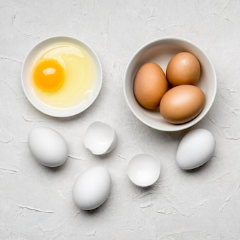 Flat lay eggs on stucco background