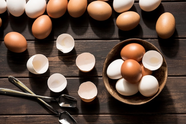 Flat lay eggs on wooden background