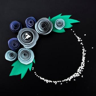 Flat lay elegant floral frame on black background
