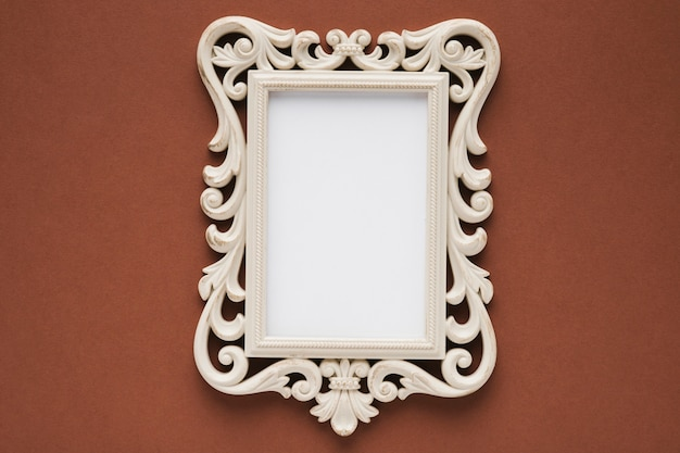 Flat lay elegant frame with brown background