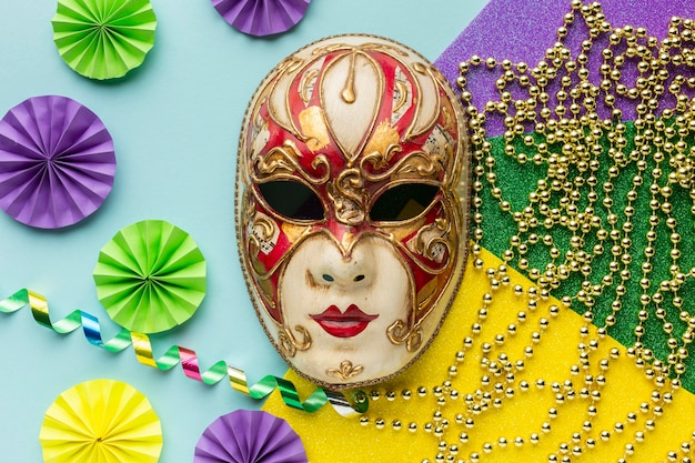 Flat lay elegant mask with pearls and decorations