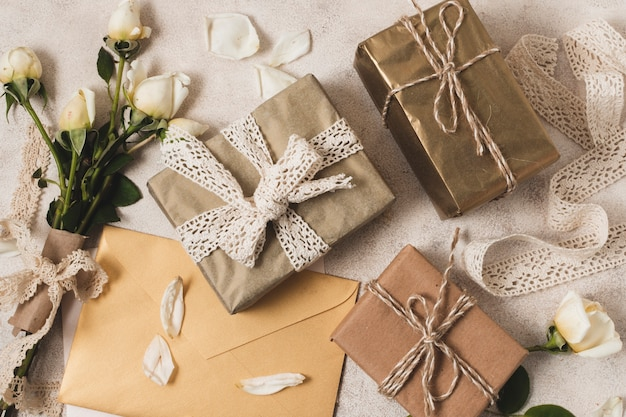 Flat lay of elegant presents with rose bouquet