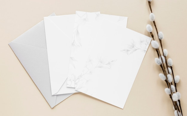 Flat lay elegant wedding invitations on table