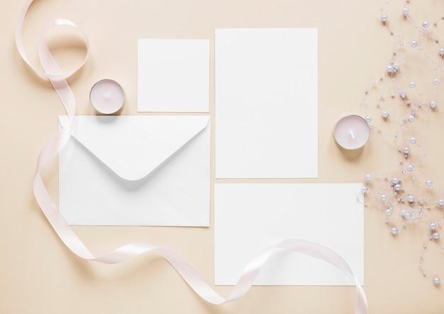 Flat lay elegant wedding invitations