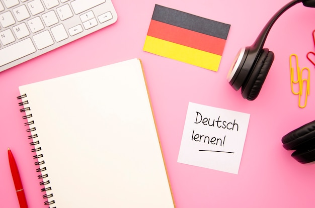 Flat lay empty notebook with german flag