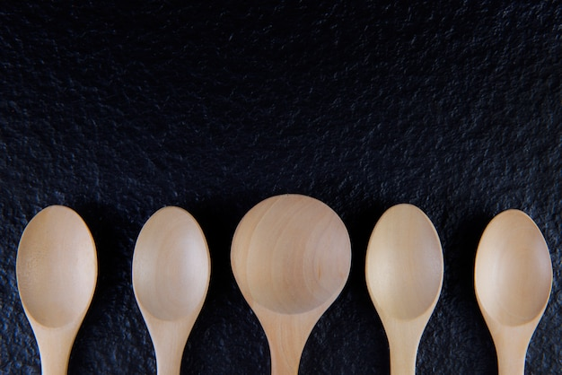 Flat lay an empty wooden spoon, five pieces
