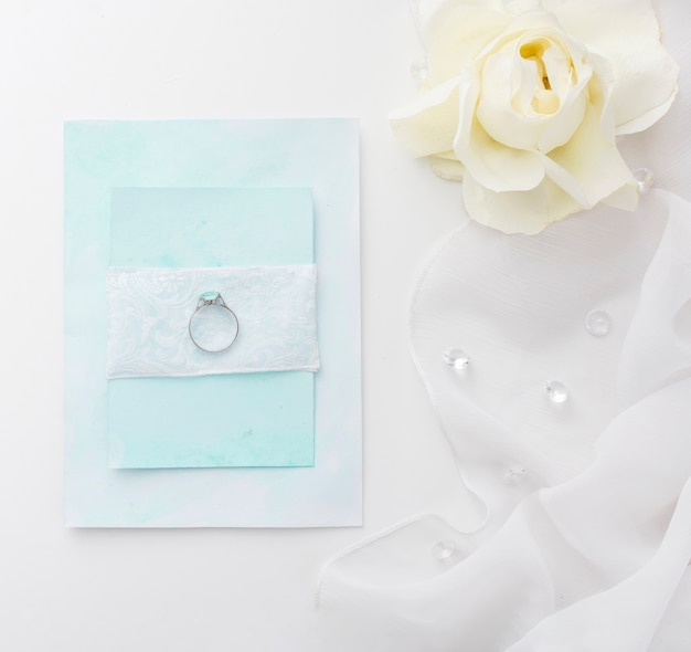 Flat lay engagement ring on wedding card
