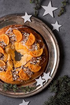 Flat lay epiphany day food with sliced oranges