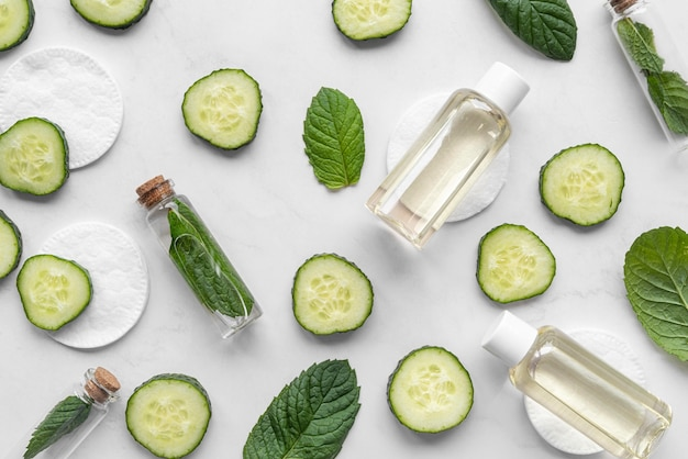 Flat lay face treatment with cucumber