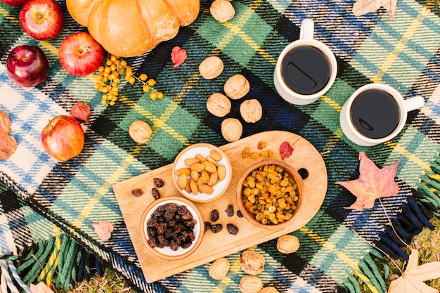 Flat lay fall season meal on picnic blanket