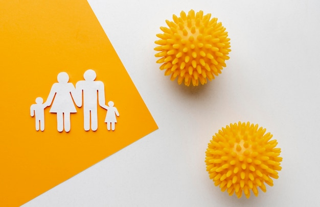 Flat lay of family made of paper with viruses
