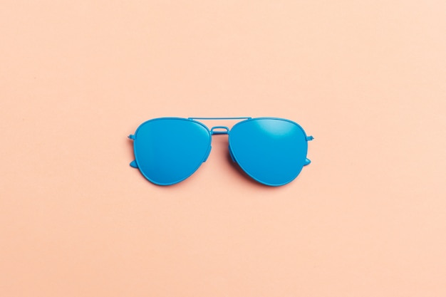 Flat lay fashion set: sunglasses on pastel backgrounds. fashion summer is coming concept.