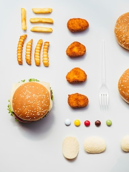 Flat lay of fast food and candy
