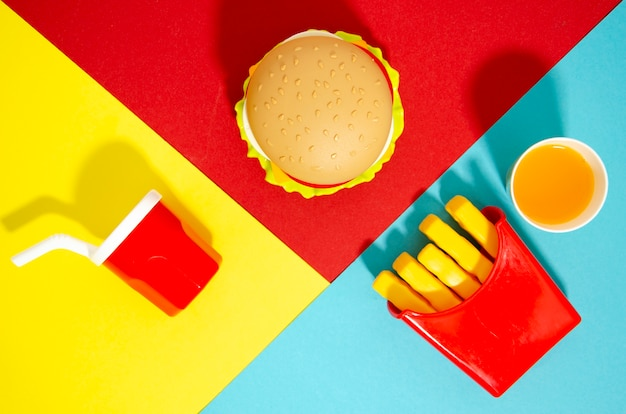 Flat lay of fast food replicas
