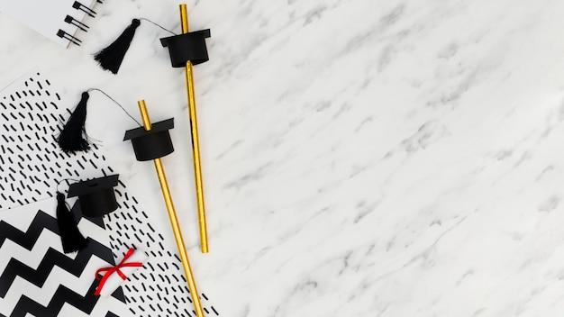 大理石の背景にフラットレイアウトお祝い卒業配置