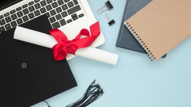Flat lay festive graduation arrangement with diploma