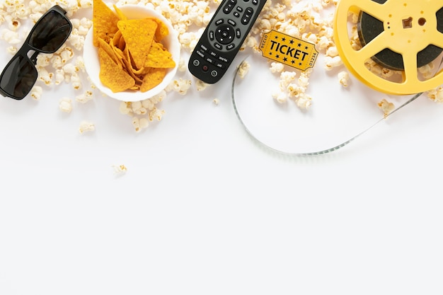 Flat lay film elements on white background with copy space