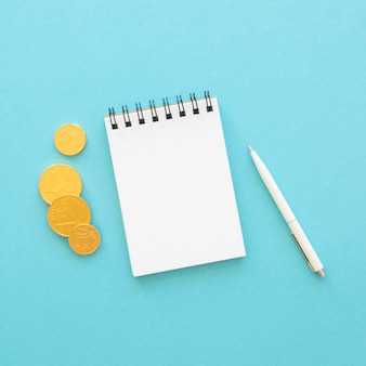Flat lay finance elements arrangement with empty notepad