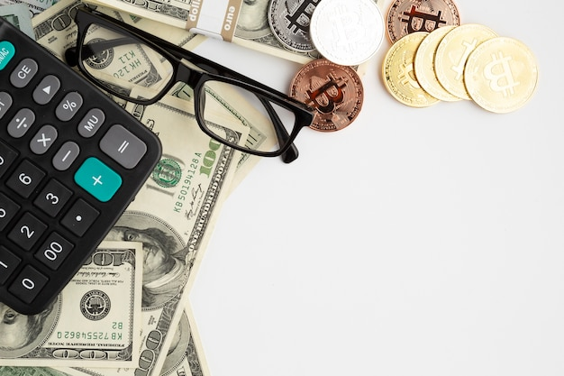 Flat lay of financial instruments with glasses