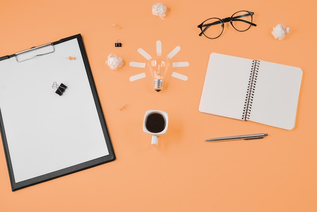 Flat lay financial planning brainstorming messy with  on orange background.