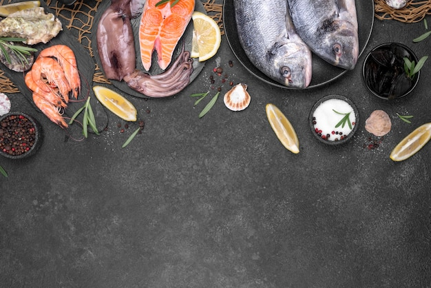 Flat lay fish and ingredients copy space