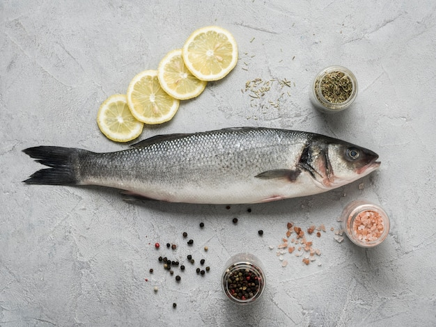 Flat lay fish with lemon and spices