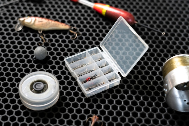 A flat lay of fishing accessories, tackles and tools gear